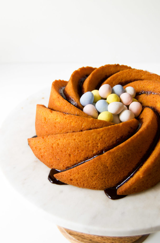 Close up of a Brazilian Carrot Cake with chocolate eggs in its center