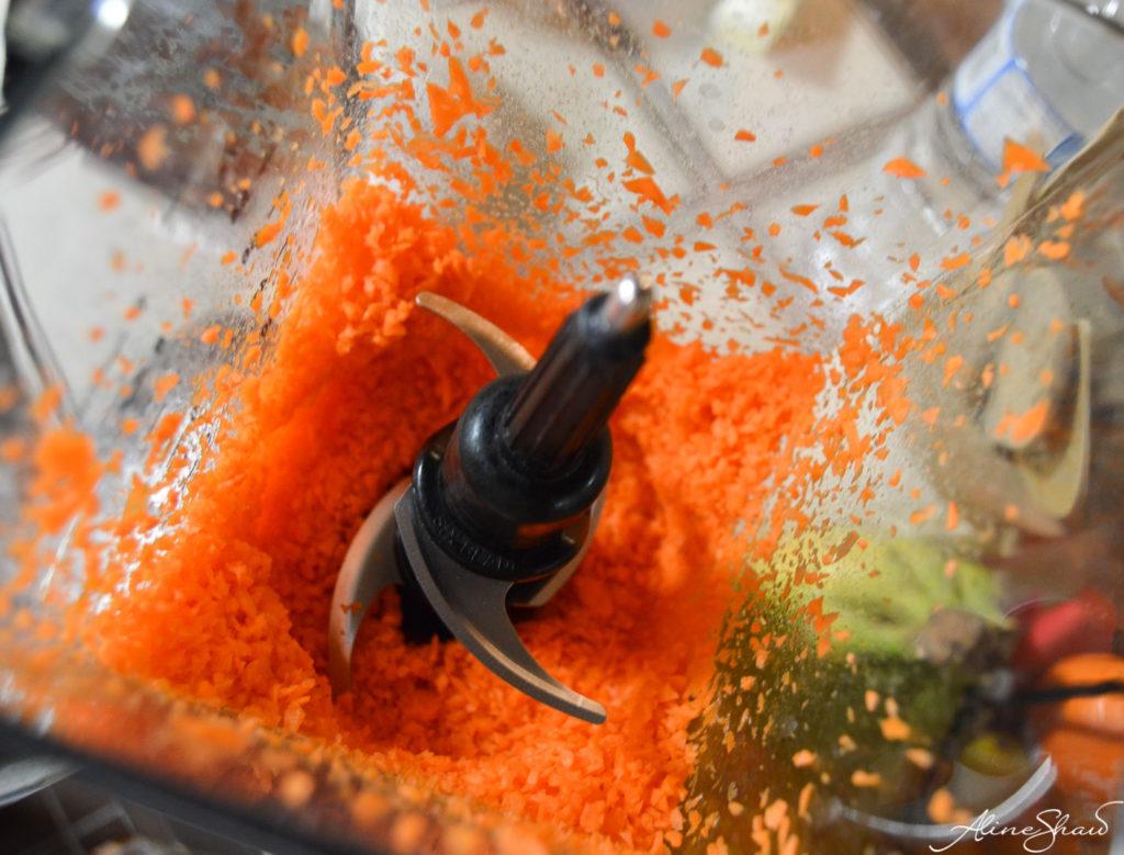 A blender shreds carrots