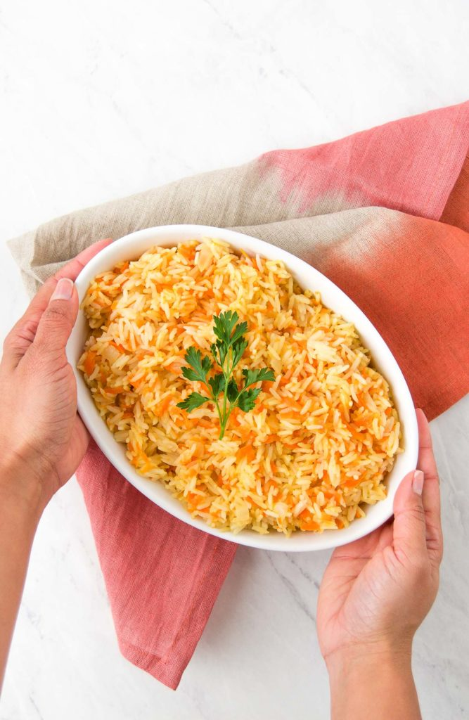 Brazilian carrot rice being served