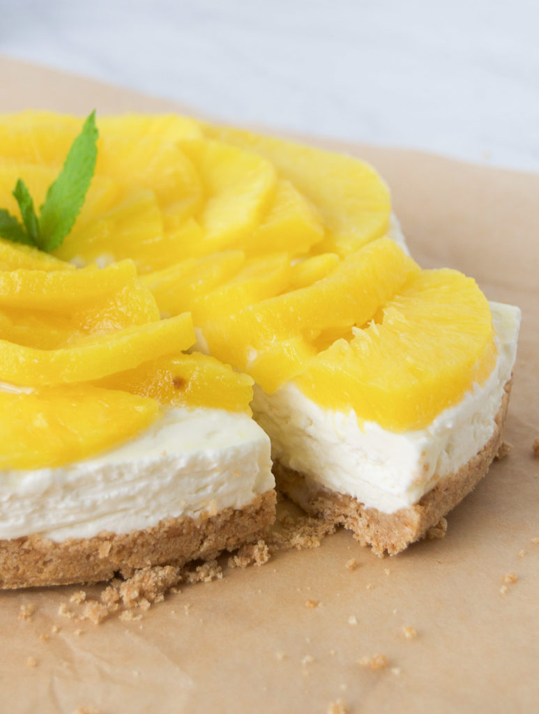 A gorgeous slice of no bake pineapple cheesecake with mint.