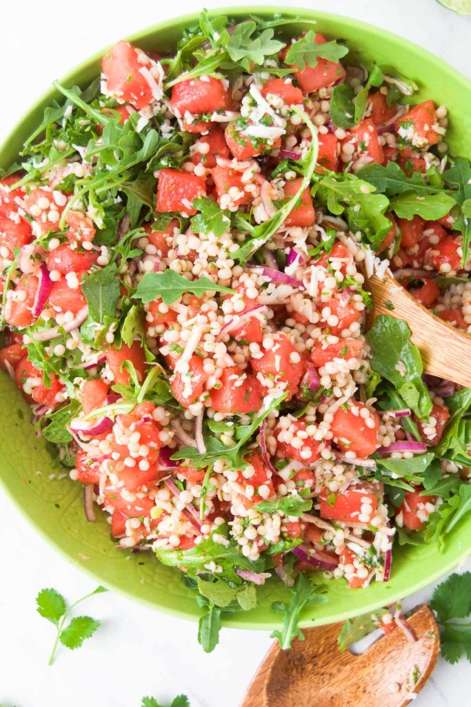 Watermelon Salad Recipe with Cilantro Honey Lime Dressing in a green bowl
