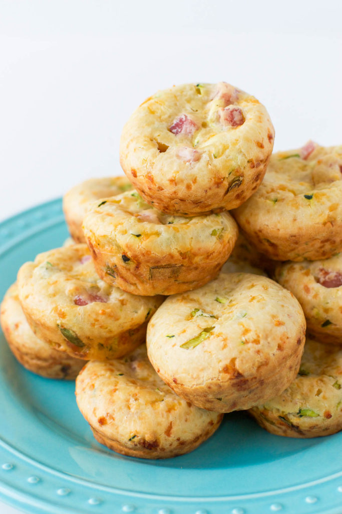 Close up of a stack of Zucchini Breakfast Muffins on a turquoise plate