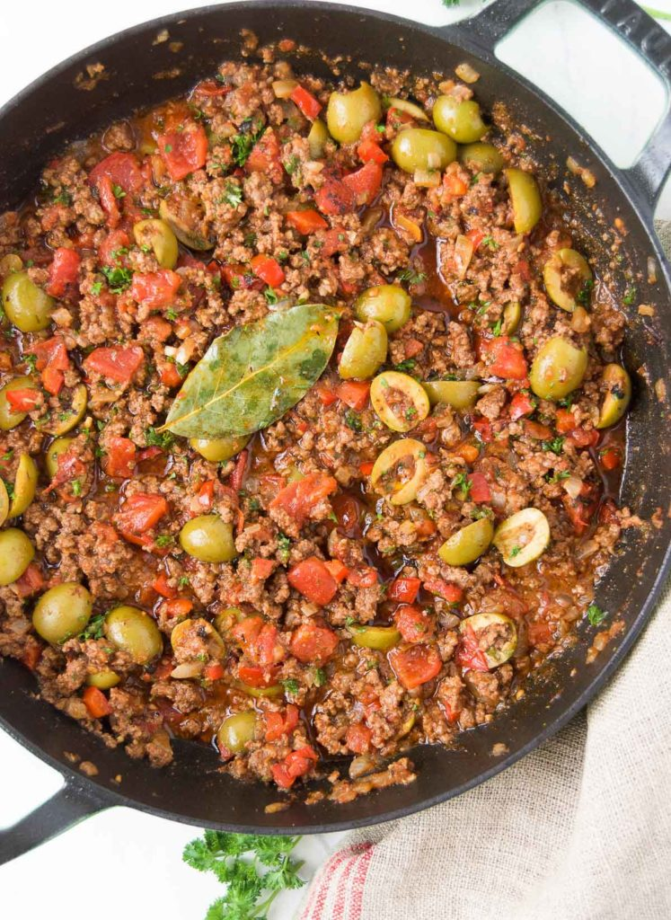 Close up of Brazilian picadillo recipe in a black braiser from above
